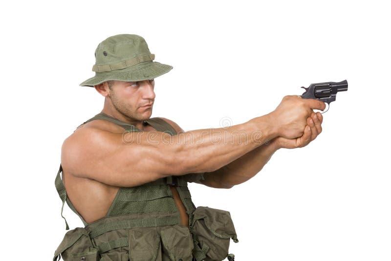 Стрельба солдата изолированная на белизне стоковое изображение rf