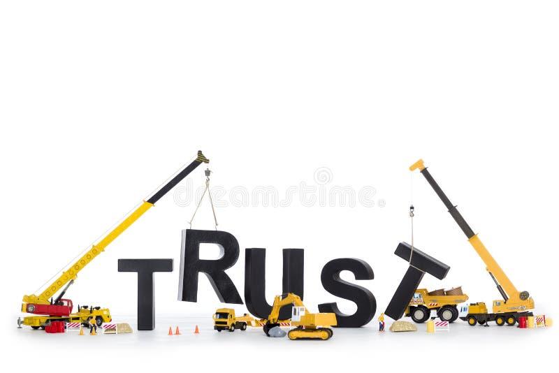 Строение вверх по доверию: Машины строя довери-слово. стоковые фото