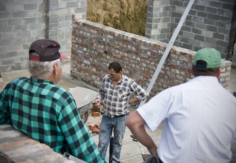 строители пролома имея стоковая фотография