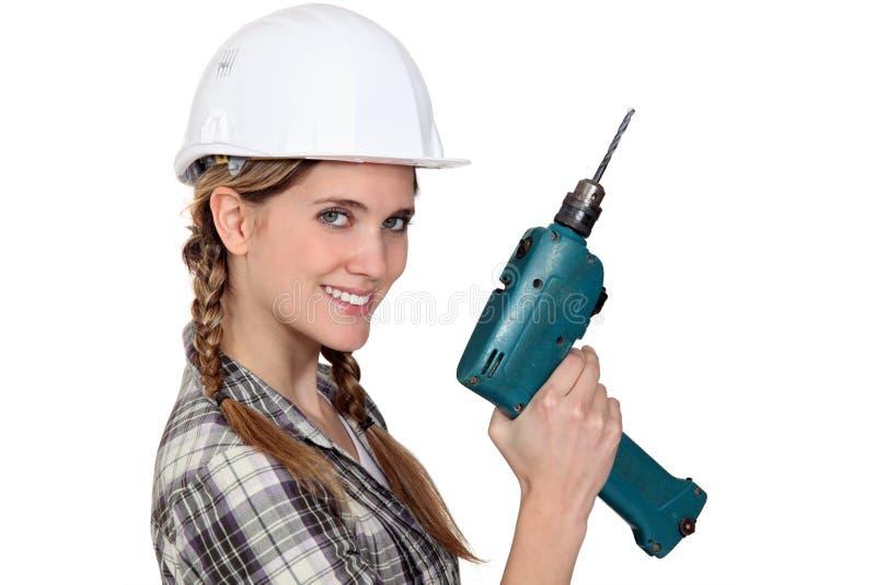 Строитель держа електричюеский инструмент стоковые фото