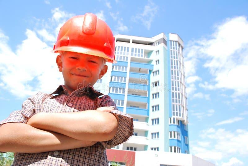 строитель мальчика стоковое изображение