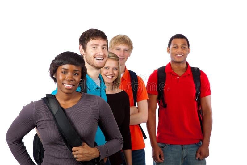 студенты группы коллежа разнообразные стоковое фото