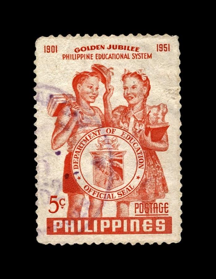 Студенты и уплотнение отдела, пятидесятая годовщина системы образования Филиппин в 1951, около 1952, стоковые изображения rf