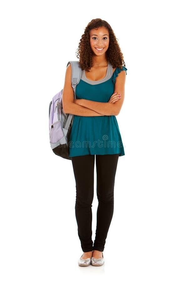 Студенты: Милая девушка стоя с рюкзаком стоковые фотографии rf