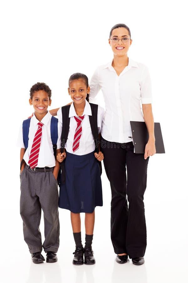 Студенты основного учителя стоковые фото