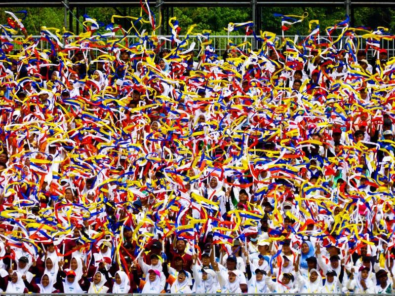 Студенты празднуя Hari Merdeka стоковые фотографии rf