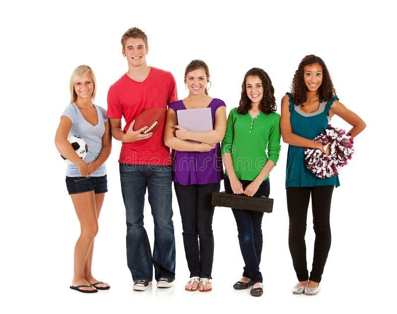 Студенты: Предназначенные для подростков студенты с различными интересами стоковое фото