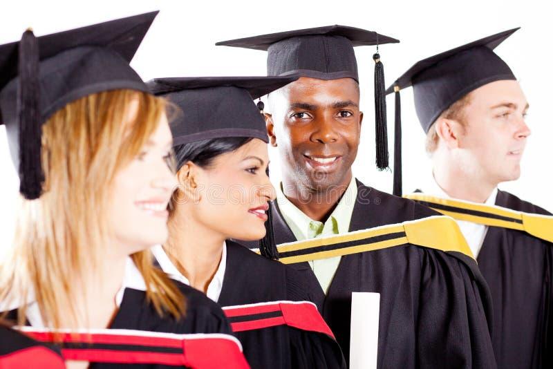 Студент-выпускники на градации стоковые изображения rf