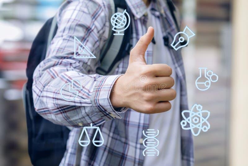 Студент показывает руке хорошее исследование стоковое изображение
