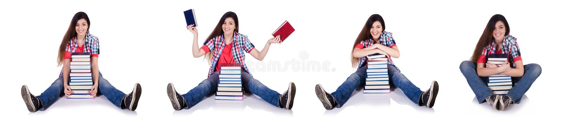 Студент с книгами изолированными на белизне стоковые изображения