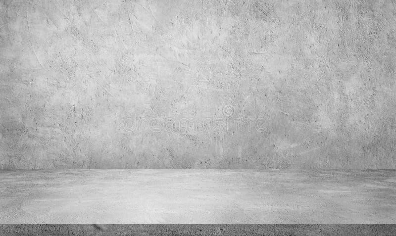 Студийный зал с текстурным фоном Пластер бетонного гранжа для использования демонстрационного продукта стоковое фото rf