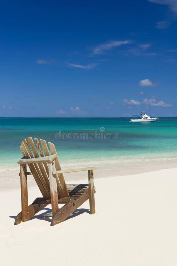 Стул пляжа на песке стоковая фотография rf