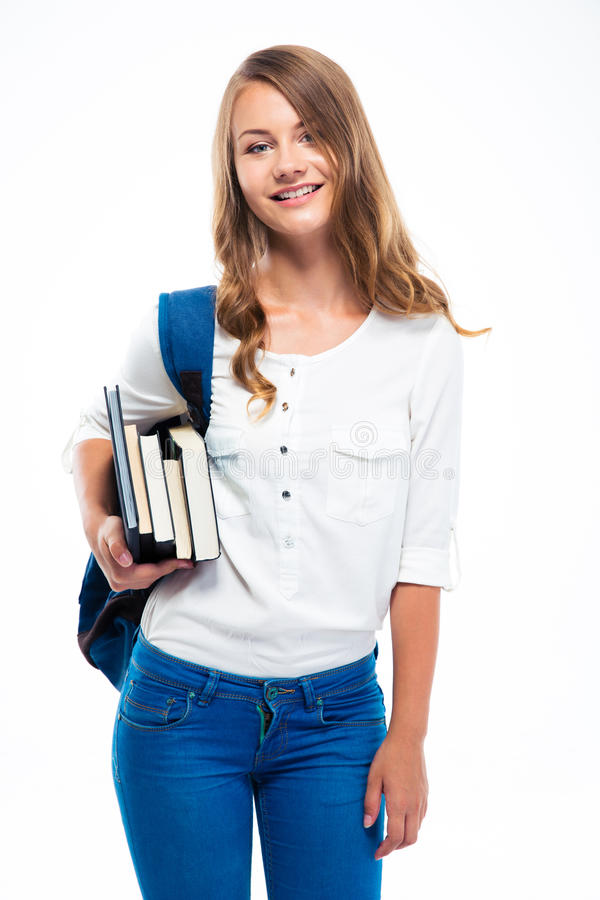 Студентка при рюкзак держа книги стоковое изображение rf