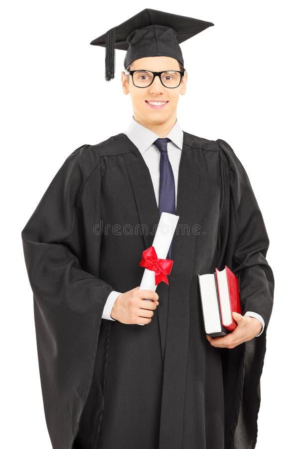 Студент в мантии градации представляя с дипломом Стоковое Фото   Студент в мантии градации представляя с дипломом Стоковое Фото изображение 37037982