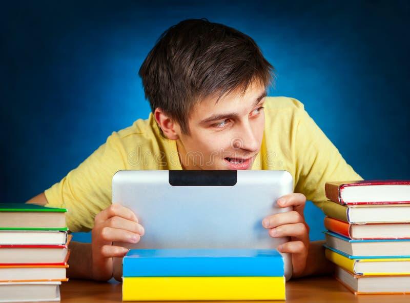 Студент с компьютером таблетки стоковое фото rf