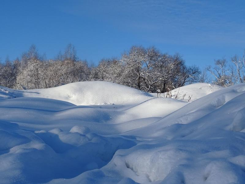 The snow of the Russian winter. Snow waves. Swim in this sea, especially after the bath is still a pleasure stock images