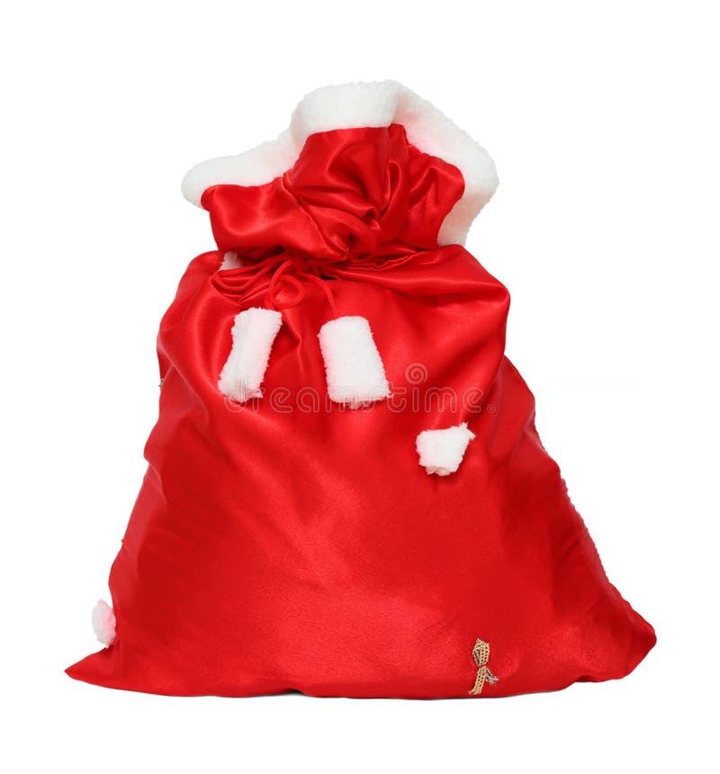 Сумка красного цвета Санта Клауса рождества стоковые фото