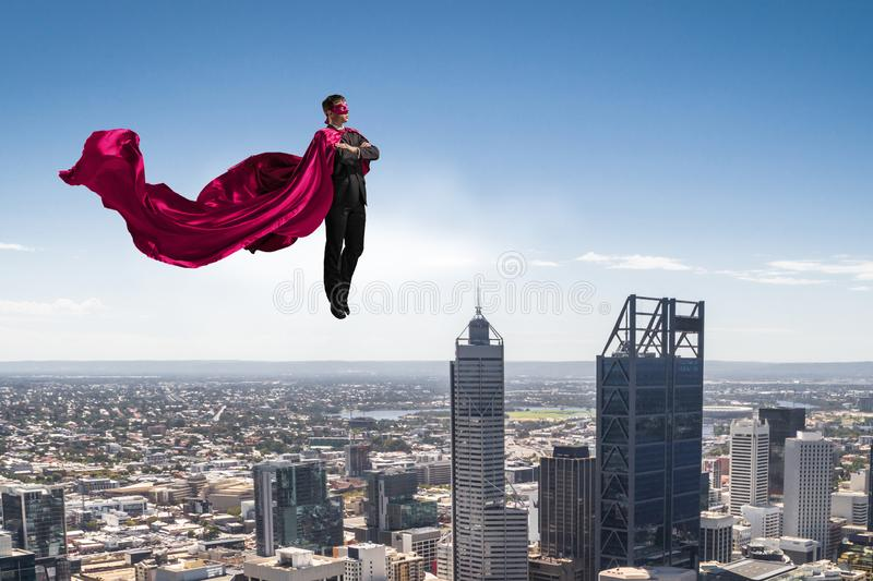 Супер человек в небе стоковое фото rf
