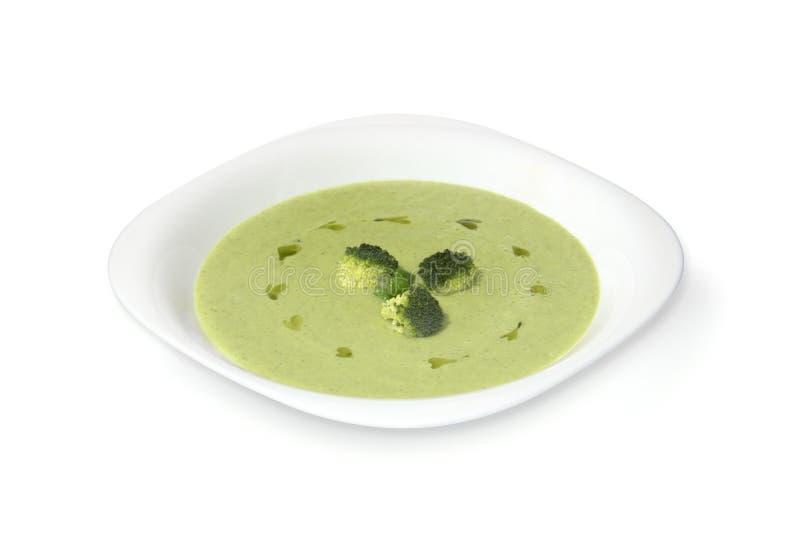 Суп брокколи сметанообразный с зелеными горохами стоковое фото rf