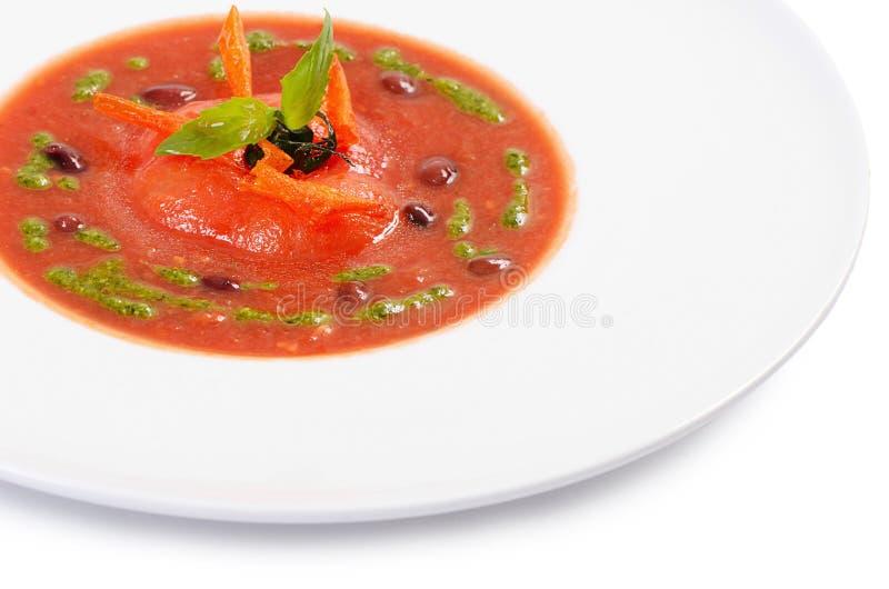 Суп от испеченных томатов с pesto стоковая фотография