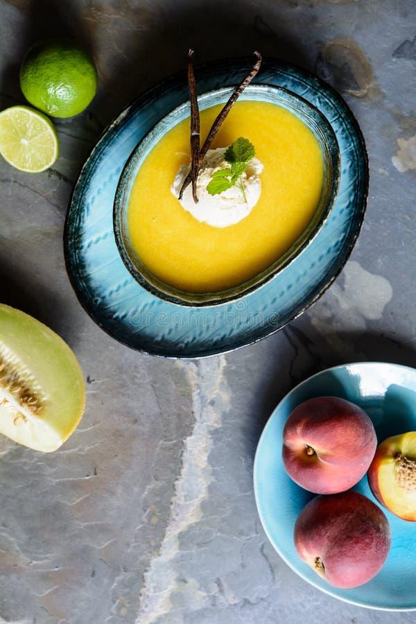 Суп плода лета с дыней и персиками Galia стоковые изображения rf