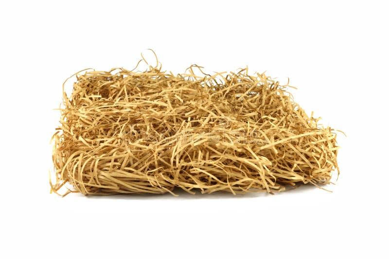 Сухой желтый стог сена Трава стога сена на backgroun изолированном белизной стоковые изображения rf
