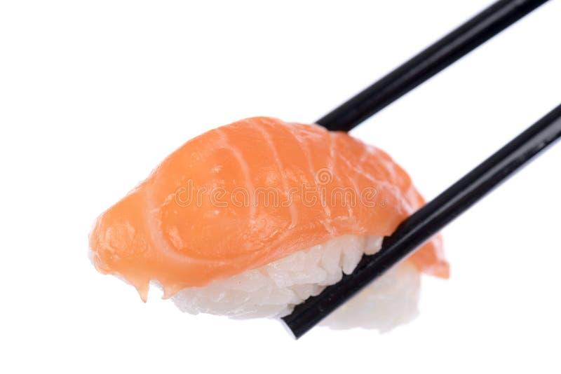 Суши, который держат палочки стоковое фото rf