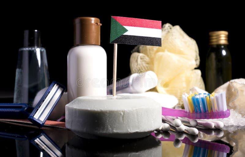 Суданский флаг в мыле с всеми продуктами для людей h стоковые фото