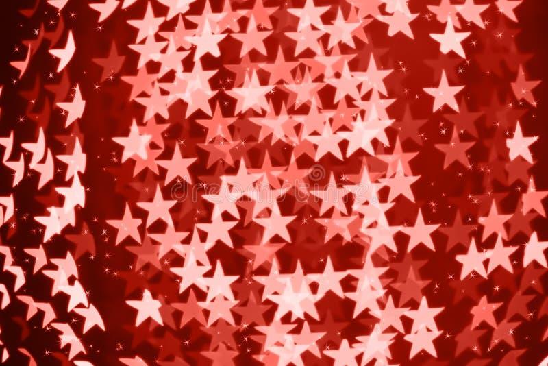 Сформированная звездой запачканная предпосылка bokeh с sparkles Живя тема коралла - цвет года 2019 стоковое изображение
