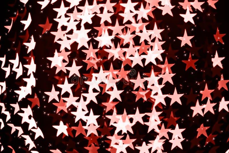 Сформированная звездой запачканная предпосылка bokeh с sparkles Живя тема коралла - цвет года 2019 стоковое фото rf