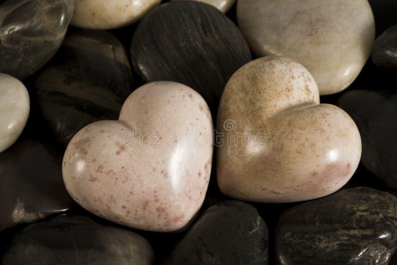 сформированные камушки сердца стоковое изображение