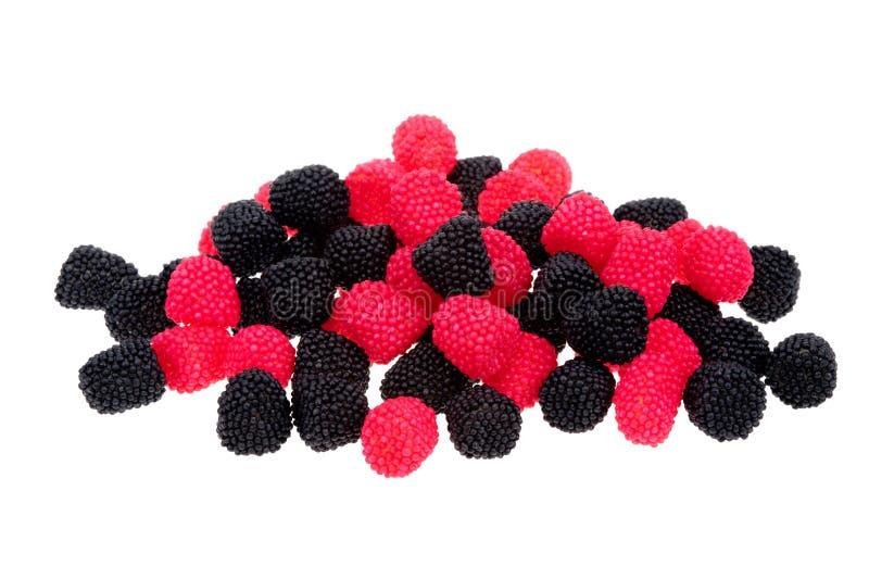 сформированный красный цвет конфет ягоды черный стоковая фотография