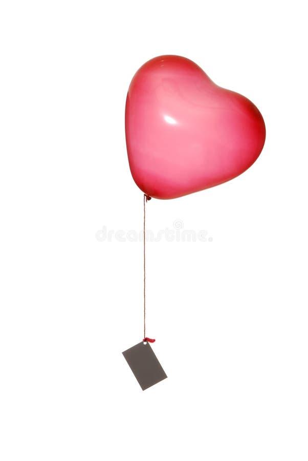 сформированный красный цвет сообщения сердца летания воздушного шара стоковые изображения rf