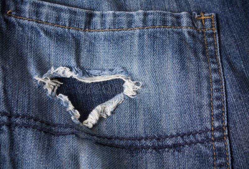 сформированный сулой пар джинсыов сердца старый стоковая фотография rf