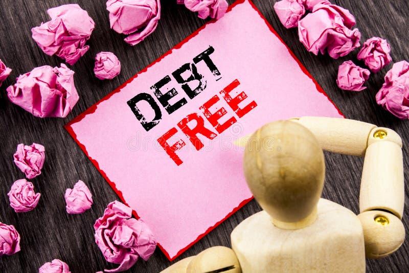 Схематический текст руки показывая задолженность свободно Свобода знака денег кредита смысла концепции финансовая от ипотеки займ стоковая фотография
