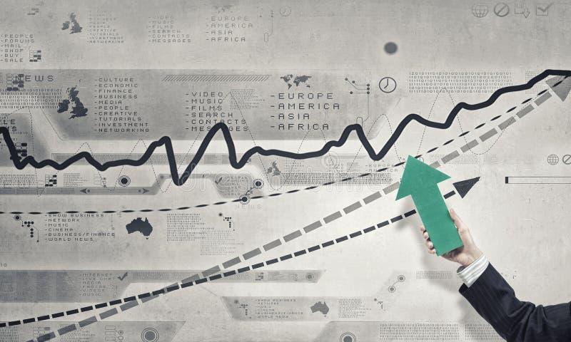 схематическим финансовохозяйственным белизна роста изолированная изображением стоковая фотография rf