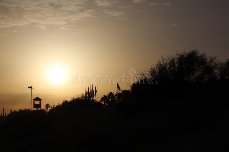 Сцена пляжа захода солнца стоковое изображение rf