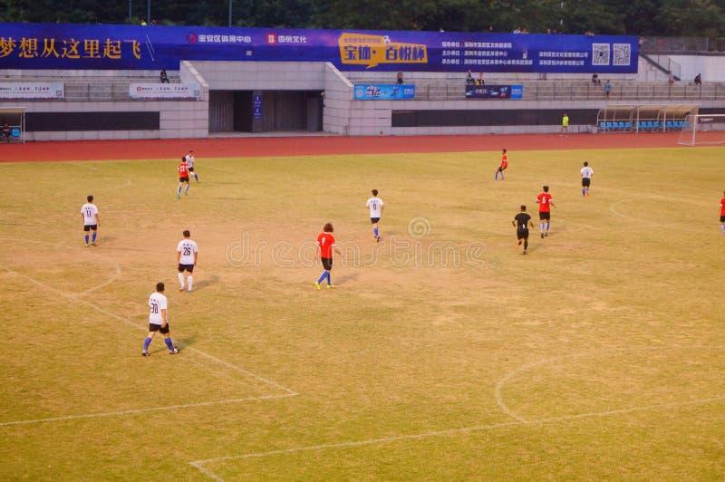 Сцена футбольного матча, в Шэньчжэне, фарфор стоковые фото