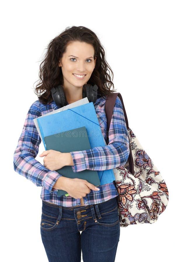 Счастливая девушка студента колледжа стоковые фотографии rf