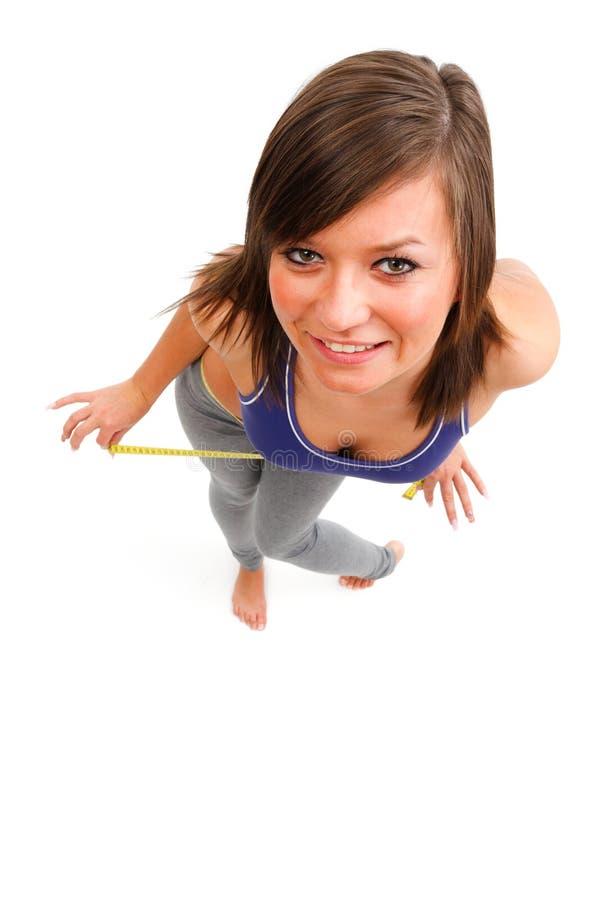 счастливая женщина ленты измерения стоковое фото