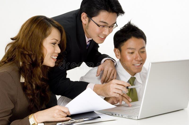 Счастливая команда дела стоковое изображение