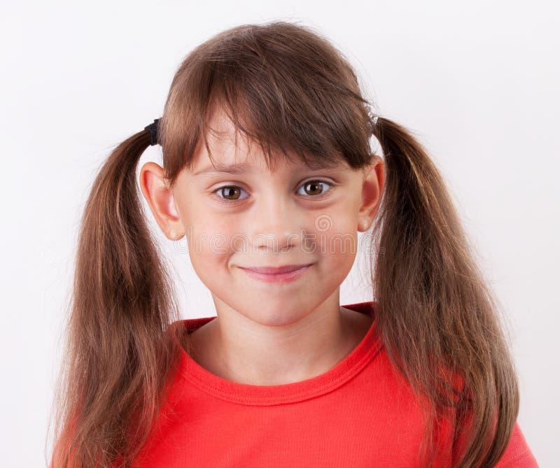 Счастливая маленькая девочка стоковая фотография