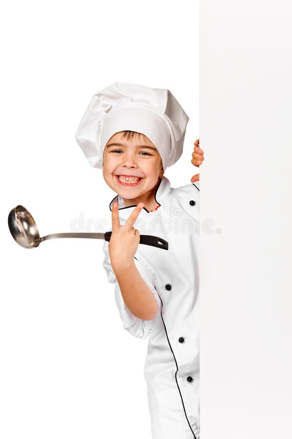 Счастливая маленькая девушка шеф-повара с уполовником. Изолировано стоковые фотографии rf