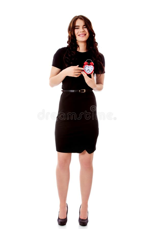 Счастливая молодая коммерсантка держа будильник стоковые фото