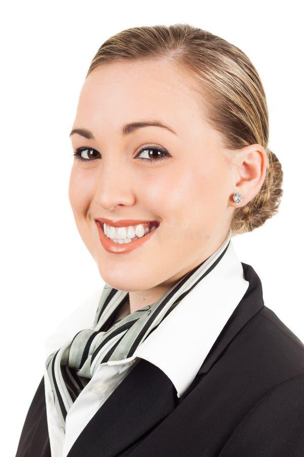 Счастливая молодая хозяюшка воздуха стоковое изображение rf