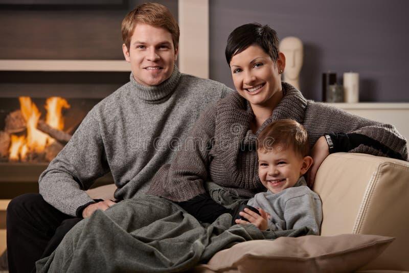 Счастливая семья дома стоковая фотография rf