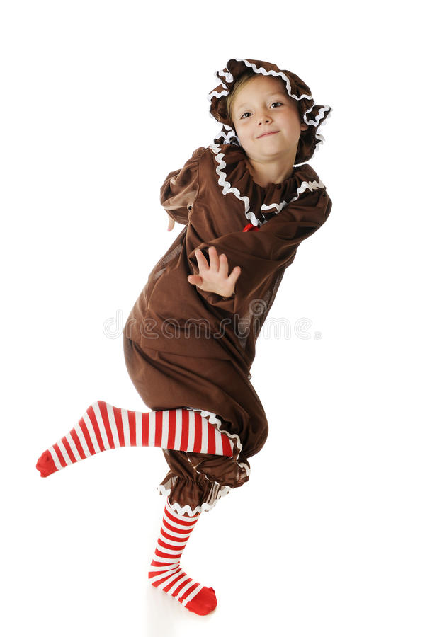 Счастливая, танцуя девушка Gingerbread стоковое фото rf