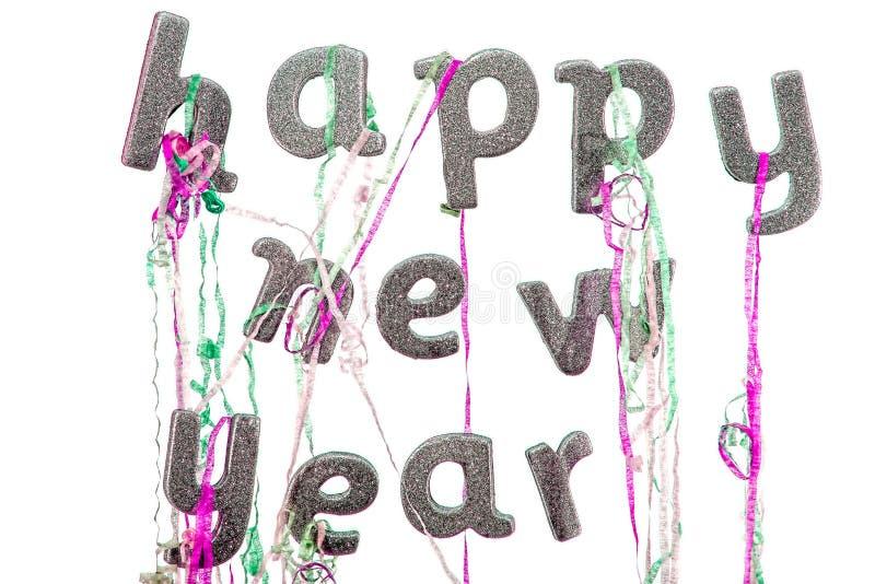 счастливое Новый Год Текст партии кануна ` s Нового Года в серебряном слове яркого блеска стоковые фото