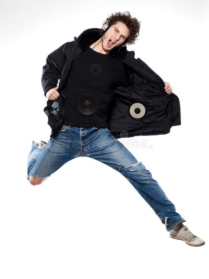 счастливое скача слушая нот человека screaming стоковое фото rf