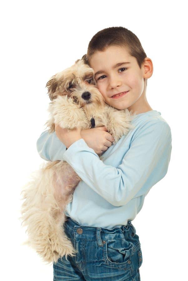 счастливо его щенок малыша удерживания стоковое изображение rf